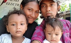 Haroon Rashid with his wife Molly, son Mohammed (left) and daughter Almeera (right) on Manus Island in Papua New Guinea.