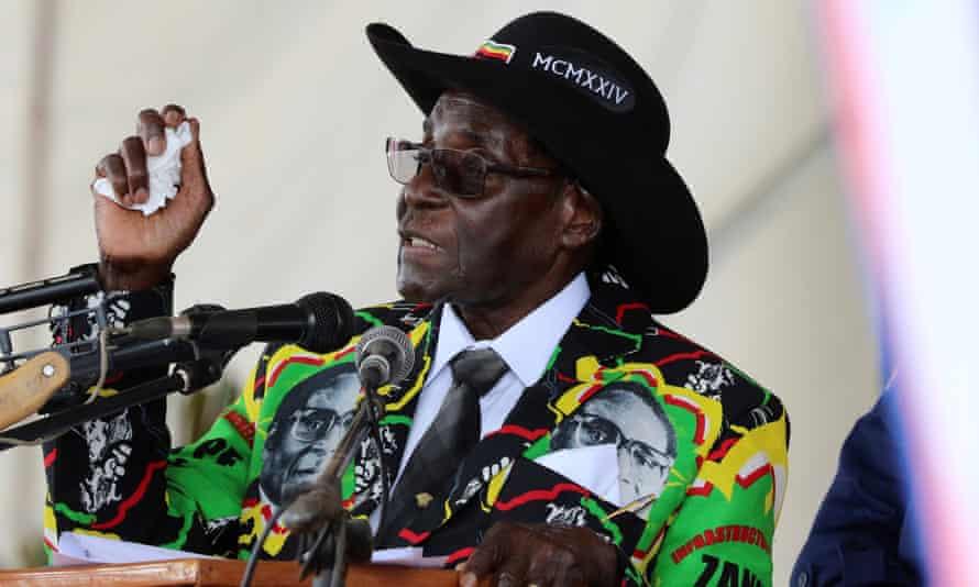 President Robert Mugabe speaks to supporters gathered to celebrate his 93rd birthday near Bulawayo.
