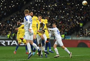 The Olimpiyskiy Stadium is illuminated by mobile phones as Olivier Giroud heads in to complete his hat-trick.