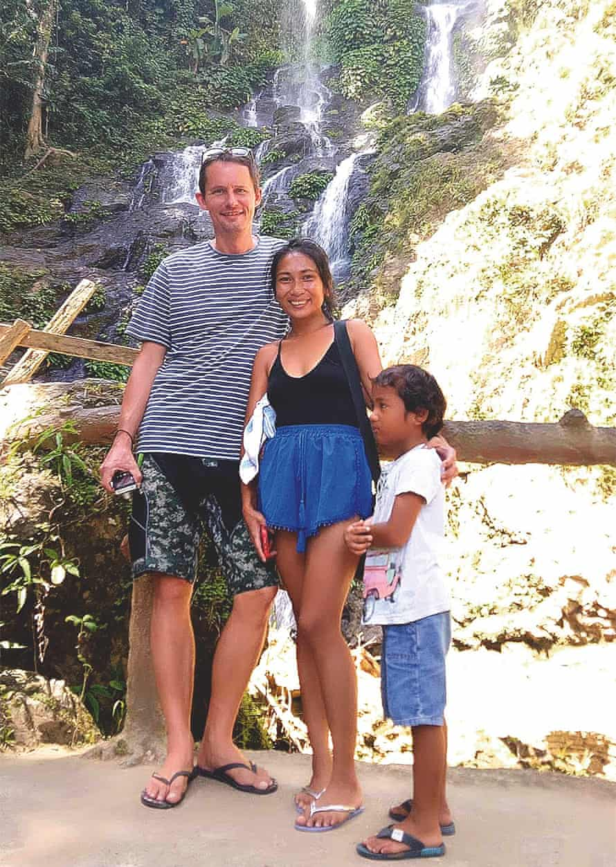 Tom Shelton, 42, in the Philippines in 2017 with his wife, Annie, and her son, Dandan.