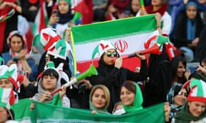 Iranian women show their support at their country's World Cup qualifier against Cambodia at the Azadi Stadium in Tehran on Thursday.
