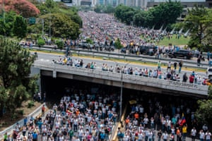 Thousands of opposition demonstrators marched against the government of Venezuelan President Nicolas Maduro