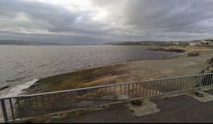 The slipway on the Buncrana pier in a Google street view image, dated September 2009, with algae growing on the surface.
