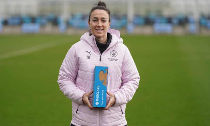 Lucy Bronze poses with her WSL player of the month gong for February.