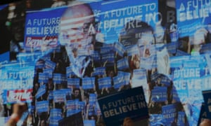 A video screen shows US Democratic presidential candidate Bernie Sanders and his wife Jane at his Super Tuesday rally in Burlington, Vermont.