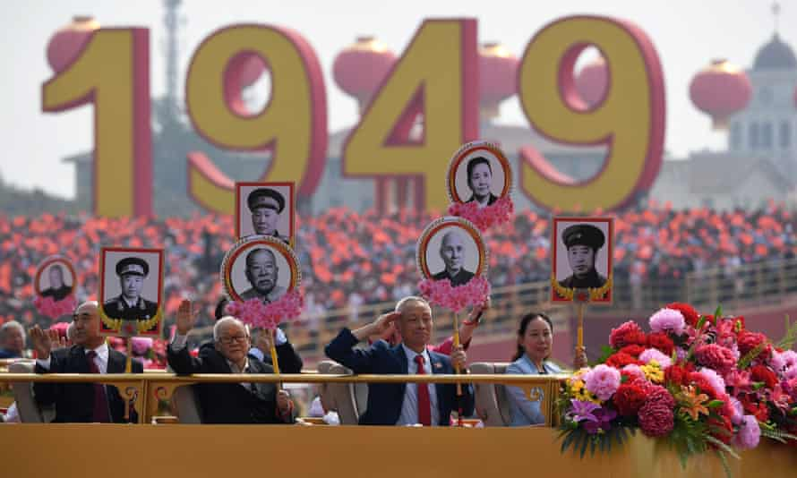 Relatives of revolutionary martyrs take part in a parade in Tiananmen Square in Beijing to mark the 70th anniversary of the founding of the People's Republic of China.