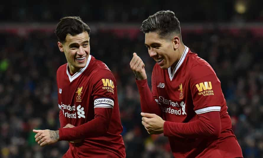 Roberto Firmino, right, celebrates his first and Liverpool's second with Philippe Coutinho, who scored the opener.