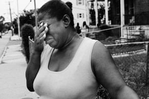 A woman reacts to news of the shooting death of her nephew Davon Ockimey on Pimlico Road on 2 July 2013