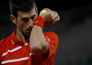 Djokovic reacts.