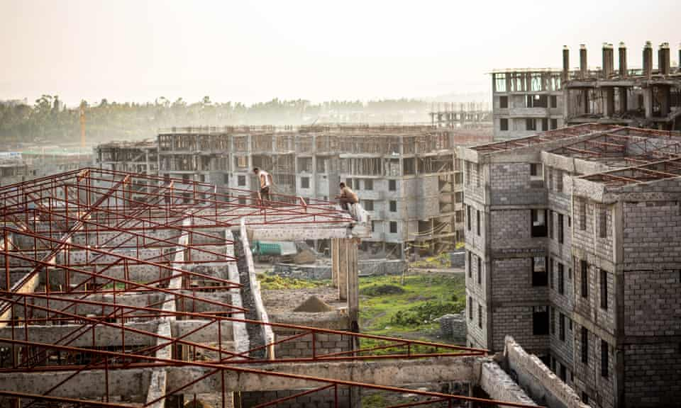 Two construction workers in Koye, the largest condominium site under construction outside Addis Ababa.