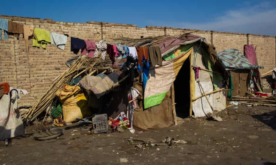 The outside of Masooma's tent on the outskirts of Jalalabad city, shared by her family of 10