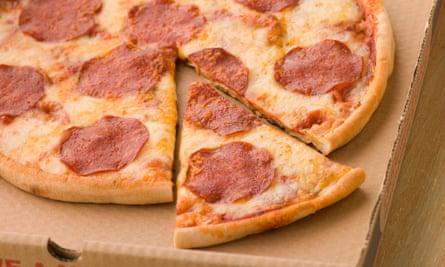 Pepperoni pizza in a takeaway box.