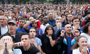 Anne Hidalgo watches France v Nigeria on a big screen outside Paris City Hall during the 2014 World Cup.