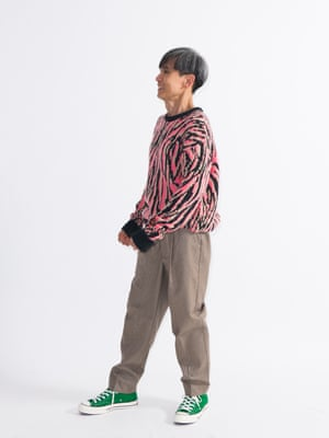 model  wears jumper, £49, and trousers, £49, both urbanoutfitters.com. Hi-top trainers, £69.99, by Converse, from office.co.uk.