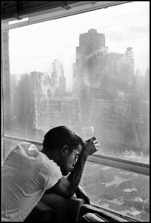 Sammy Davis Jr. looks out a Manhattan window, 1959