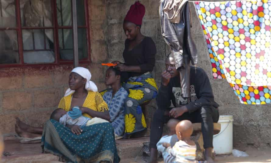 A family outside their home in Lusaka, Zambia