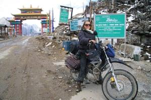 Antonia Bolingbroke-Kent sat on her motorbike in Tawang.