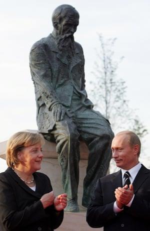 Putin with Angela Merkel at the Dostoyevsky Monument in Dresden, 2006.