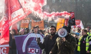 UCU members on strike over pay and pensions marched towards the Universities UK headquarters on 4 December.