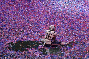 Brandon King of the New England Patriots sits in confetti on the pitch after winning Super Bowl LIII against the Los Angeles Rams at Mercedes-Benz stadium in Atlanta.