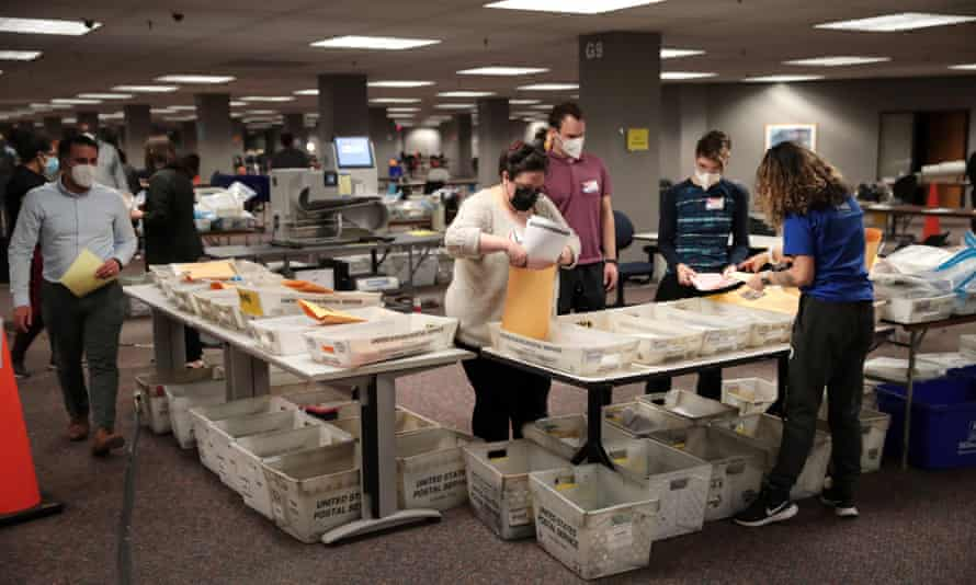 Picture of election officials counting absentee ballots in Milwaukee, Wisconsin