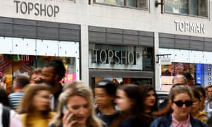People walk past a Topshop and Topman store, owned by Arcadia Group, in central London.