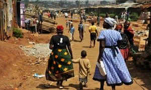 Two women and a child in Kibera.