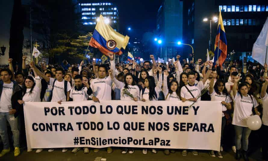 Peace marchers in Bogotá, with a banner reading 'For all that unites us and against all that separates us'.
