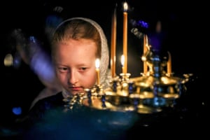 A girl from the Pokrov Orthodox children's social rehabilitation centre attends a Christmas liturgy at St Nicholas Church near Moscow.