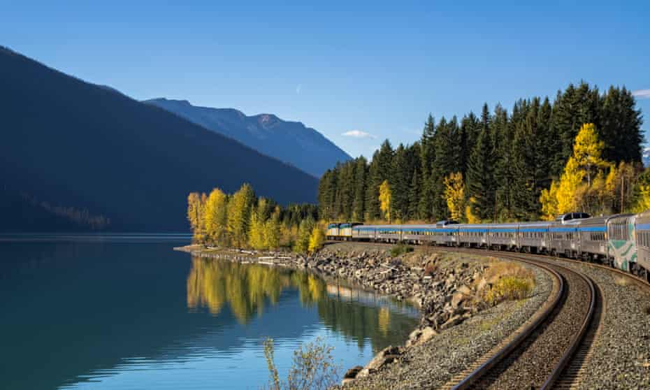 Passenger train along Moose Lake in Jasper National Park, Alberta, Canada.