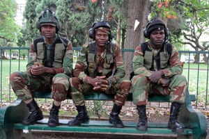 Zimbawean soldiers sitting on a bench in Harare