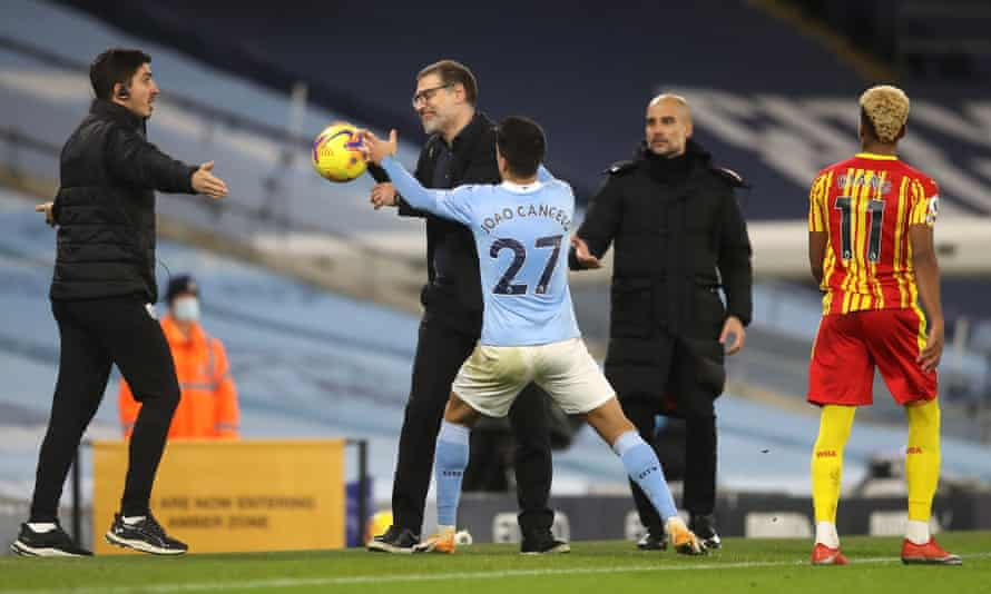 Slaven Bilic (centre) is reluctant to hand João Cancelo the ball as Manchester City push for a winner in vain.