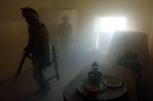 US marines in Fallujah search a house for insurgents bathed in the haze of their own grenades