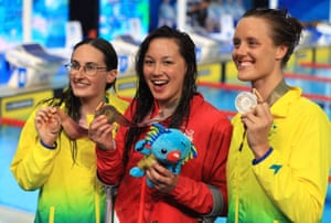 2018 Commonwealth Games - Day TwoEngland's Alice Tai, centre, Ellie Cole, right and Ashleigh McConnell show off their medals.