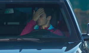 Mikel Arteta covers his face as he arrives at Manchester City training on Monday.