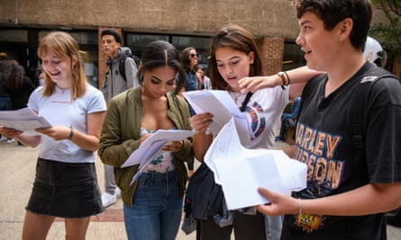Students react as they receive their GCSE exam results at Stoke Newington School and Sixth Form