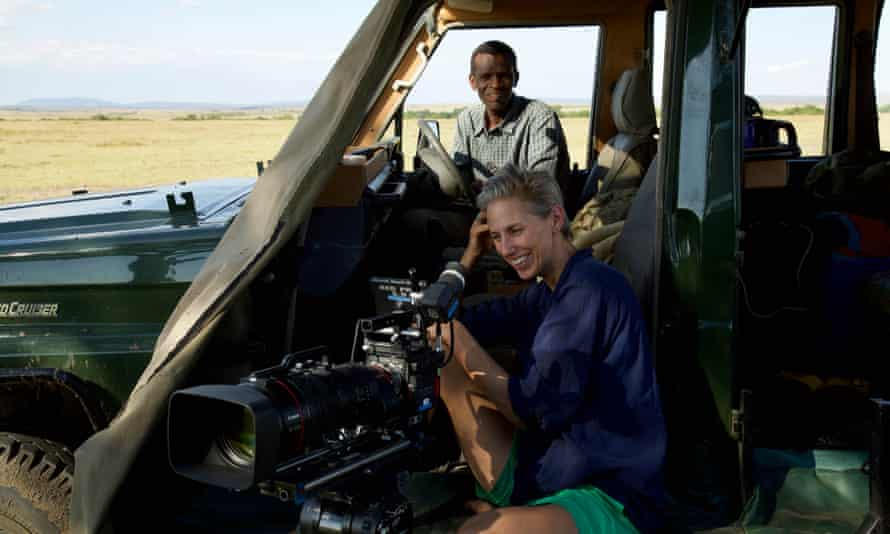 Cinematographer Sophie Darlington and expert guide and film driver Sammy Munene in the Masai Mara whilst filming topi antelope for The Mating Game