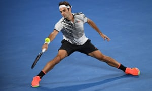 Roger Federer stretches to return against Stanislas Wawrinka.