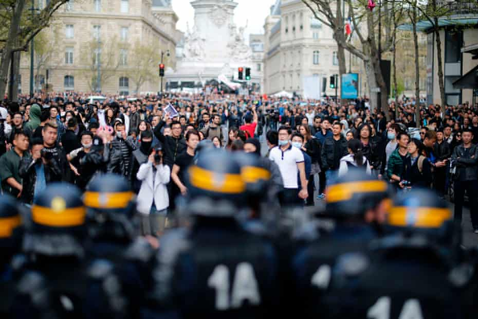People face riot police as they take part in a demonstration in Paris after Liu Shaoyo was killed by police in 2017.