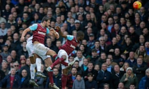 Andy Carroll rises highest to head home.