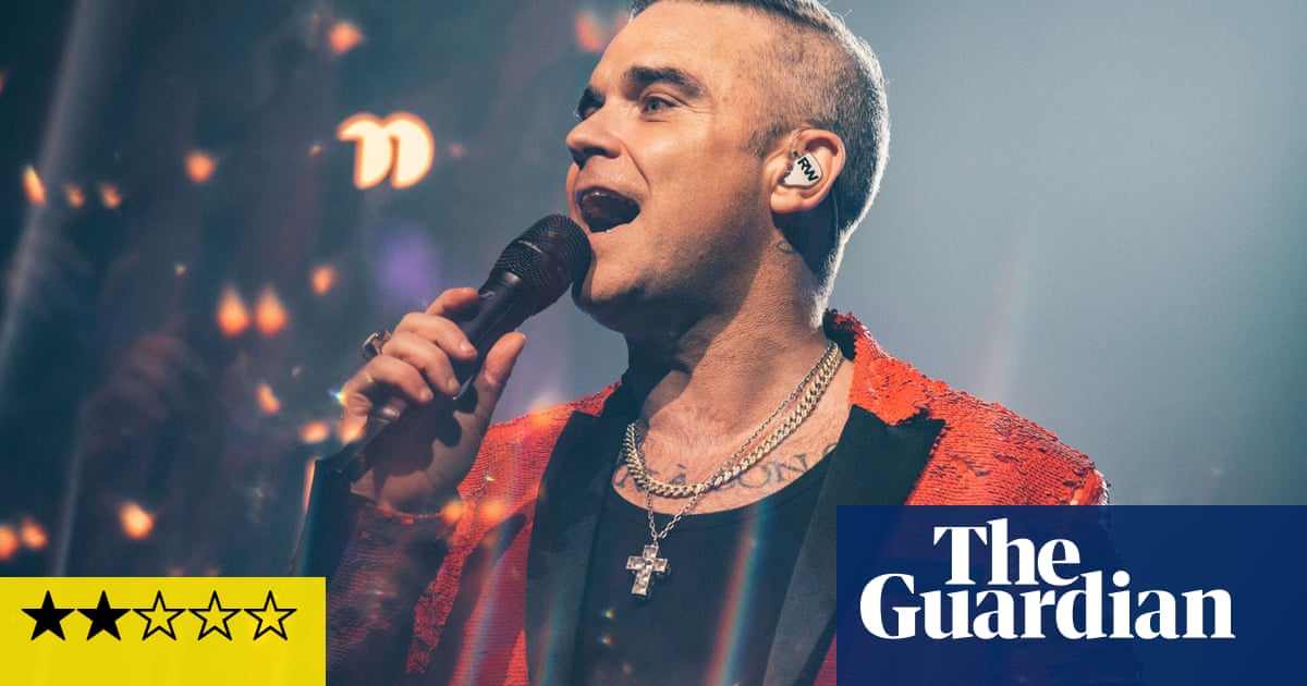 Robbie Williams review – Christmas party host is desperate to be loved