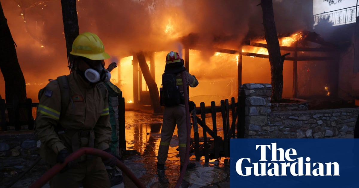 Greece: thousands of residents flee as wildfires reach outskirts of Athens – video