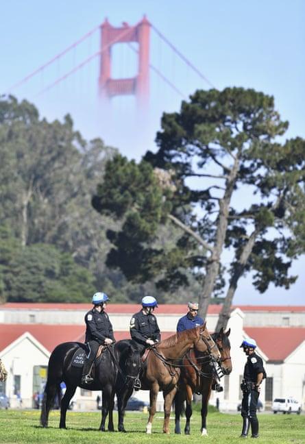 Park police officers patrol Crissy Field near the Golden Gate Bridge.