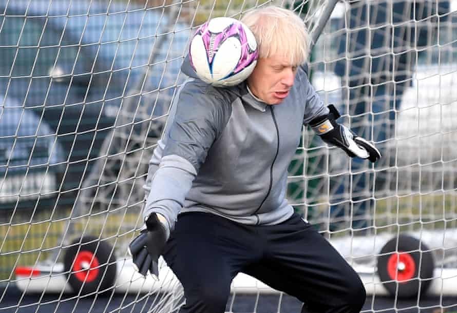 Boris Johnson gets into a tangle when trying to save a shot before a girls' match in December 2019.