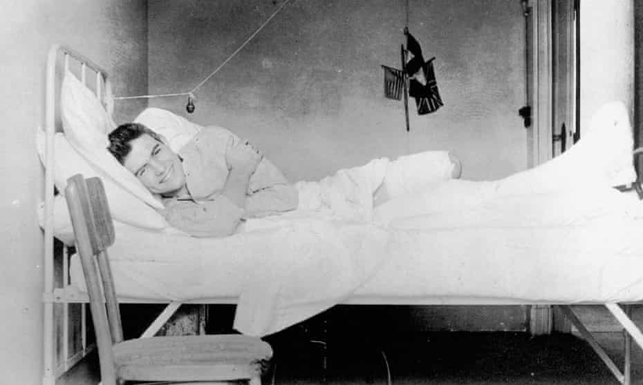 'It has been fairly conclusively proved that I cannot be bumped off' ... Hemingway recovering from injuries at the American Red Cross Hospital in Milan, Italy, 1918.