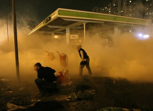Demonstrators set off a fire extinguisher during a protest against the construction of a petrol station in a densely populated area in Kiev