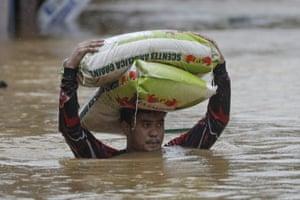 A man carries sacks of rice in Marikina