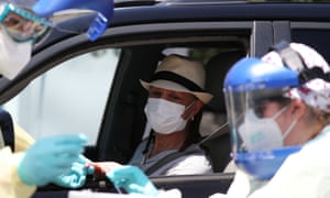 Healthcare workers administer a coronavirus antibody test in Los Angeles.