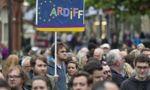 A man holds a pro EU sign during a anti-Brexit rally on June 28, 2016 on the Hayes in Cardiff, Wales