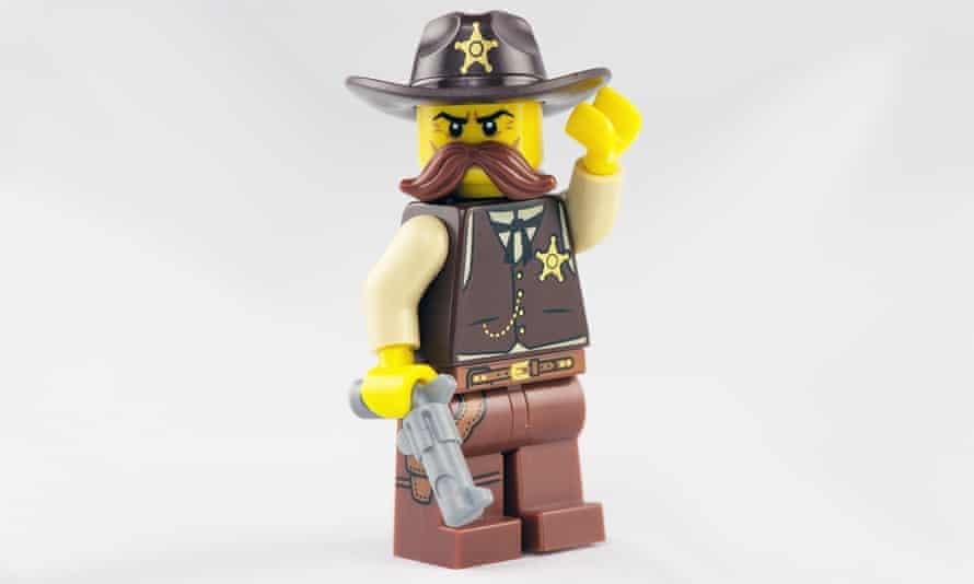 An isolated Lego Sheriff Minifigure